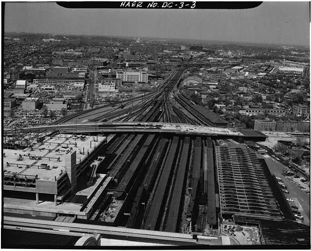 The Union Station railyard: a long row of parallel tracks, which eventually converge to a few tracks.